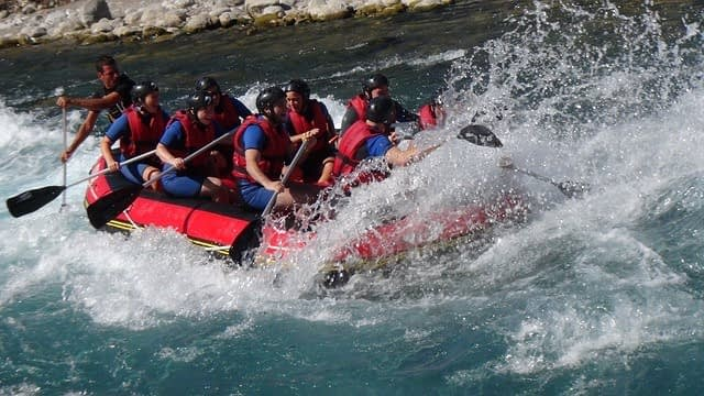 group of men in a river boating